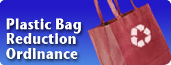 Plastic Bag Reduction Ordinance - red reusable shopping bag